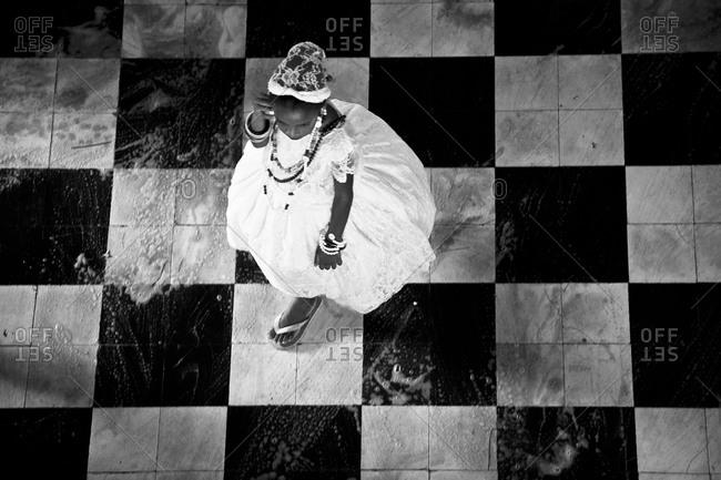 Lençóis, Bahia, Nordeste, Brazil - January 23, 2008: A girl in a white dress walks across a soapy floor