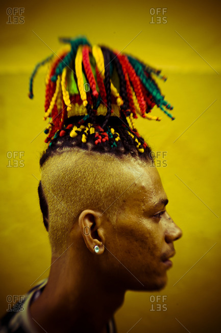 Salvador, Bahia, Nordeste, Brazil - January 27, 2008: A man with colorful ribbons woven in his hair