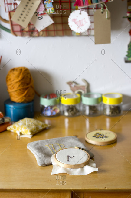 Needlepoint in round frame on craft worktable