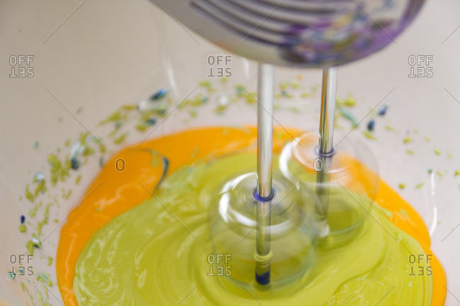 Various paint shades being mixed with electric mixer