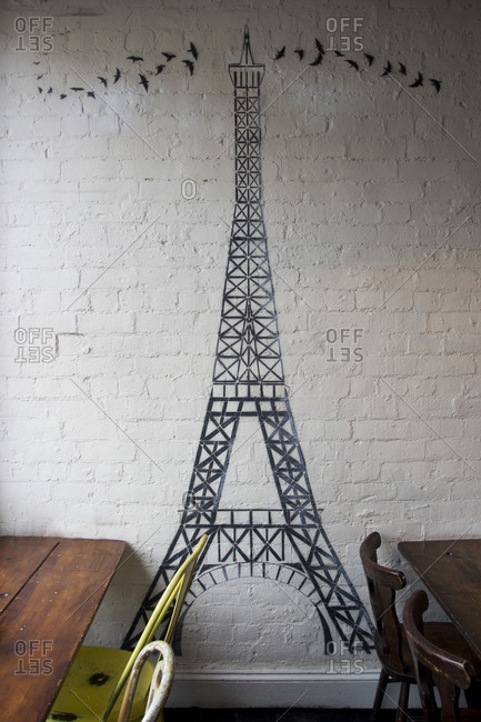Drawing of Eiffel Tower on wall in cafe