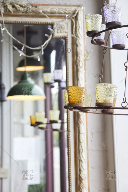 Hanging lamps and mirror reflecting window light