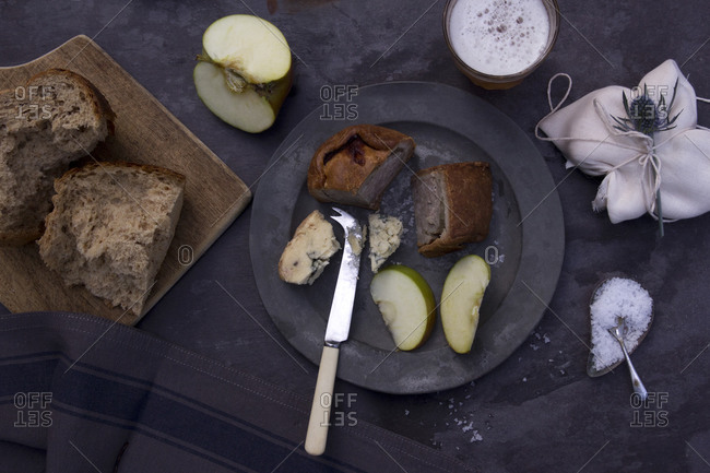 Overhead of various slices of bread and fruit on table