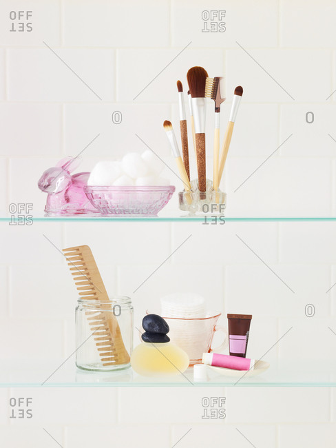 Cosmetic products on glass shelves
