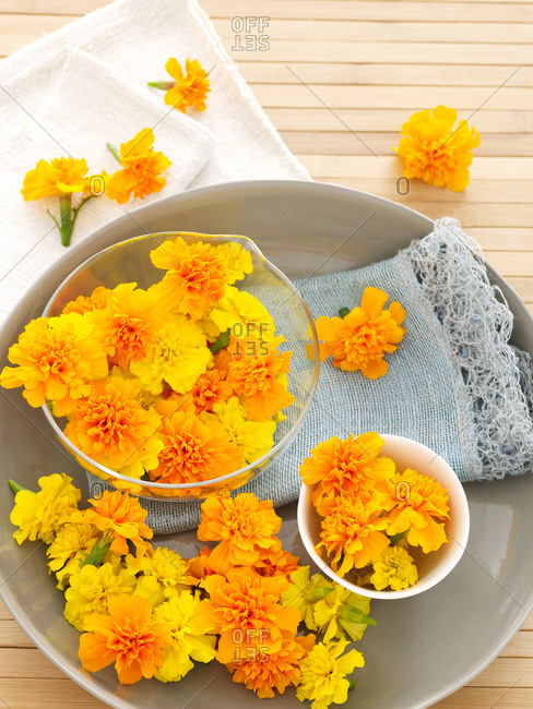 Orange marigolds sprinkled in jars
