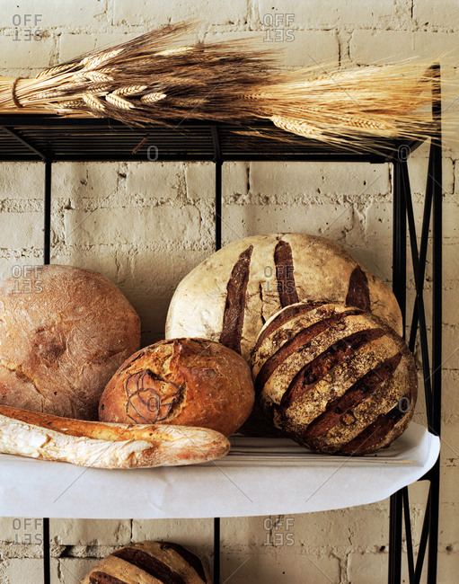 Rustic bread loaves on a shelf