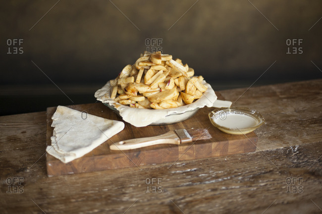 Unbaked apple pie on wooden table