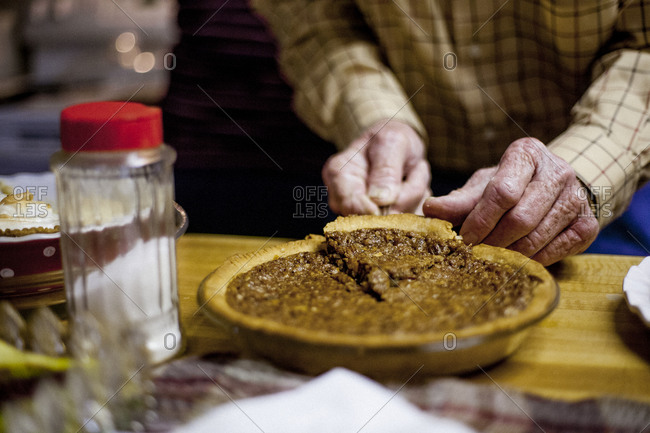 Close up of man serving a slice of pie