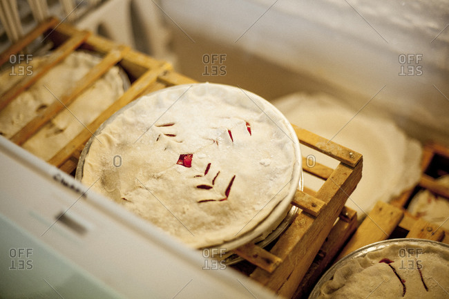 Unbaked pies in a freezer