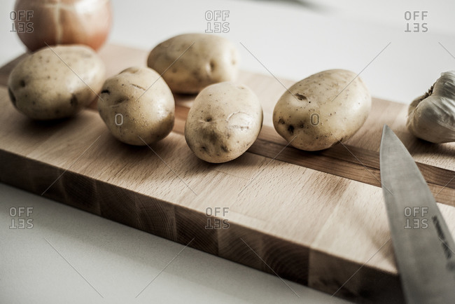 Potatoes on a cutting board