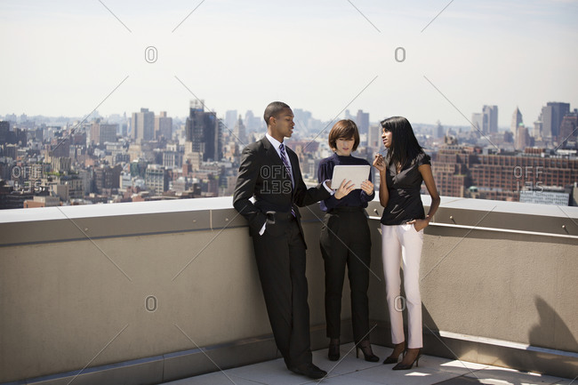 Corporate employees holding a meeting on an urban roof