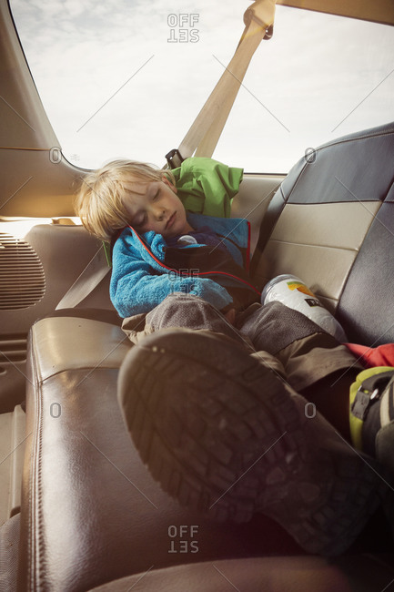 Child asleep on a van seat