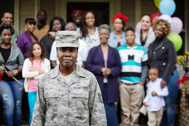 Female military member with family at homecoming