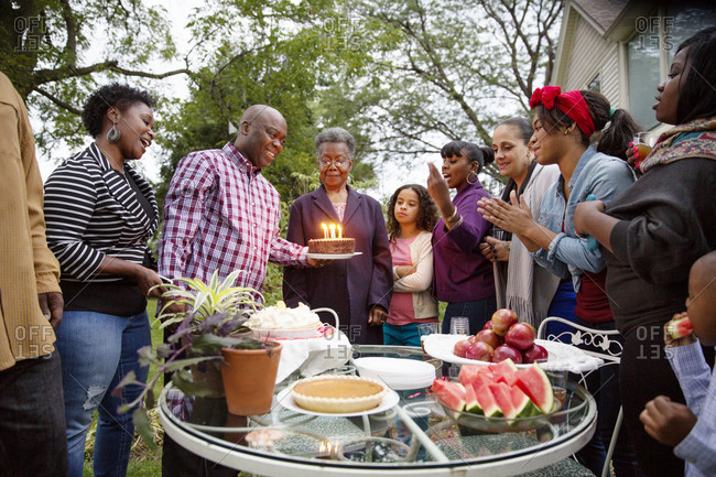 Family gathered for grandmother's outdoor birthday celebration
