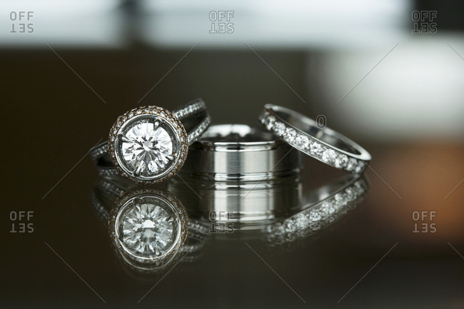 Wedding rings on a shiny table