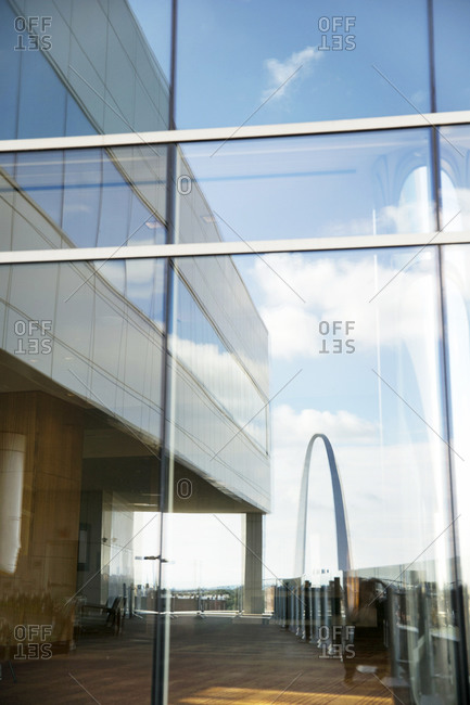 The St. Louis Arch reflected in a window