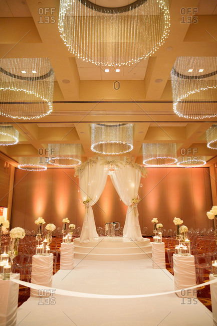 A hotel ballroom decorated for a wedding ceremony