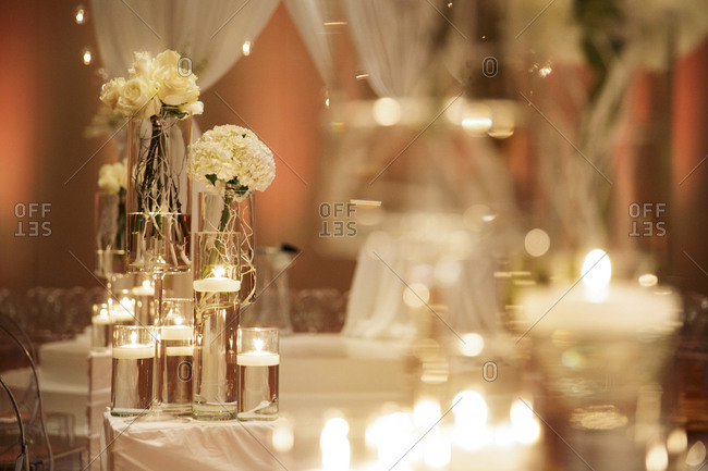 Flowers and candles in glass columns