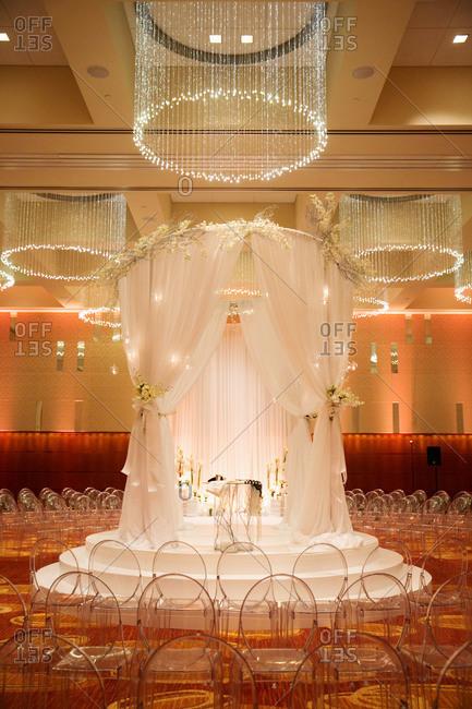 A white huppah set up for a wedding