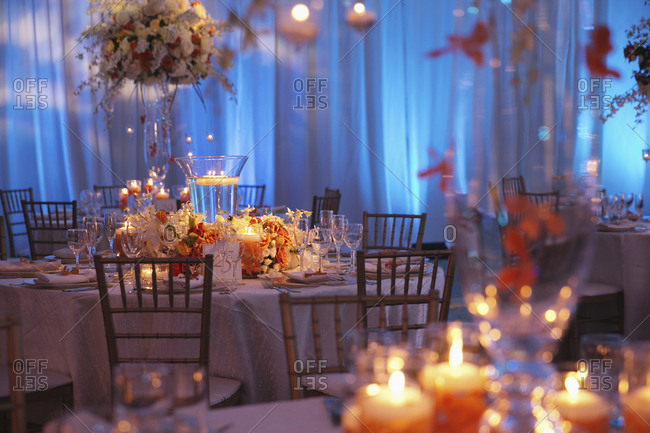 Tables decorated with floral centerpieces