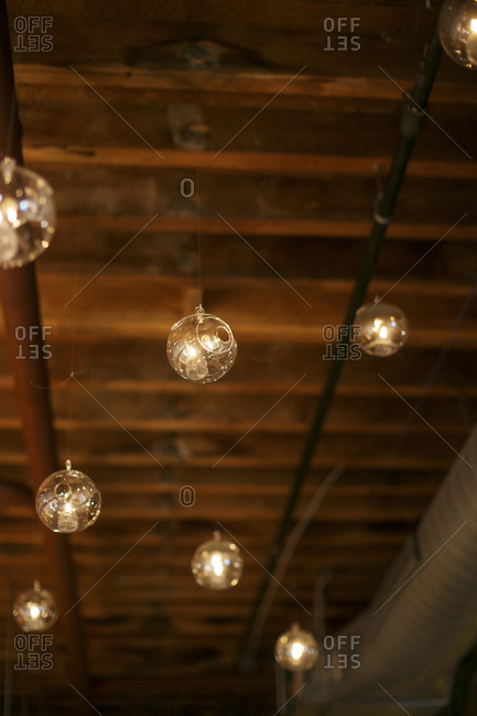 Candles hanging from wooden rafters