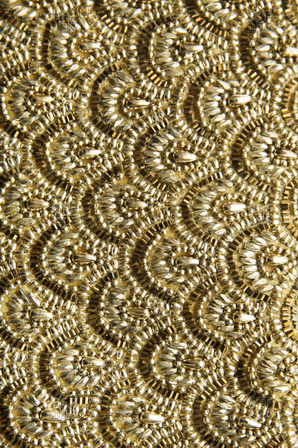A gold beaded pattern