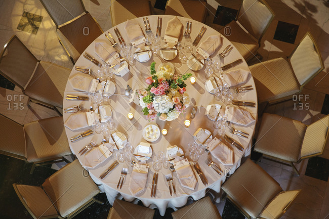 A round table set for a wedding reception