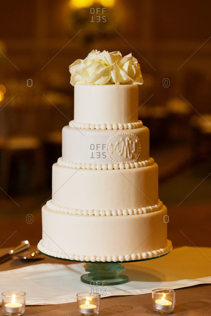 A four-tiered white wedding cake