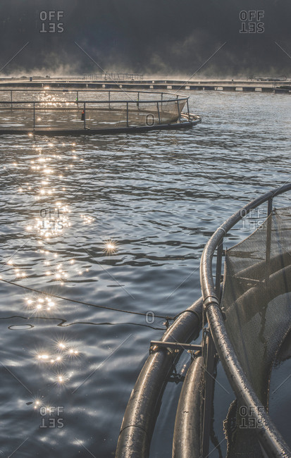 Cages for fish farming in mountain lake