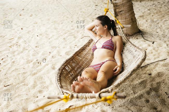 Woman relaxing in a hammock near El Nido