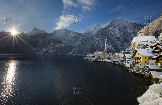 View of Hallstatt and Dachstein over lake Hallstaetter See at sunrise in winter