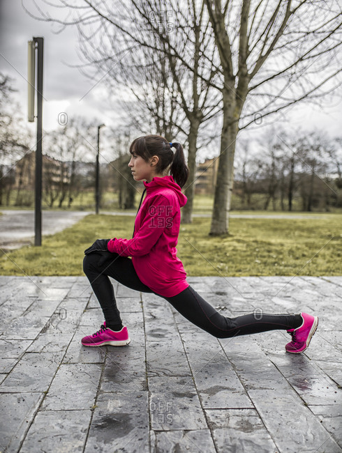 Young woman in a lunge in park