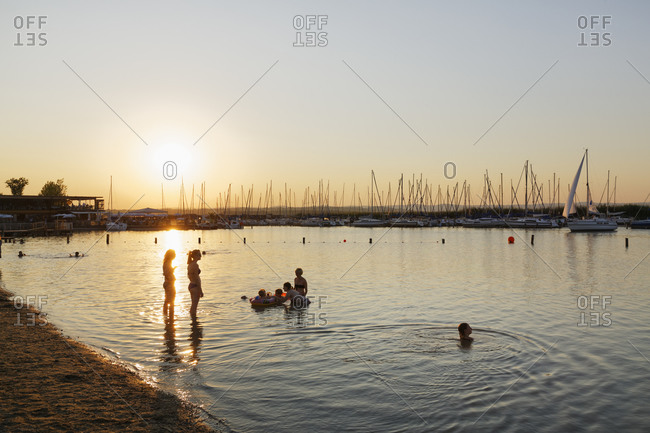 Rust at Lake Neusiedl, Austria - July 19, 2014: Swimming area and marina at sunset
