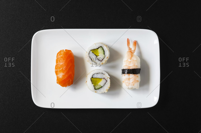 Variety of Nigiri Sushi and Inside-Out on plate