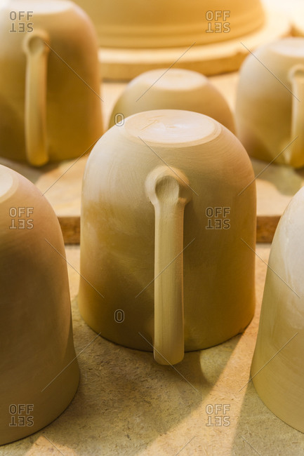 Earthenware cups drying in a pottery