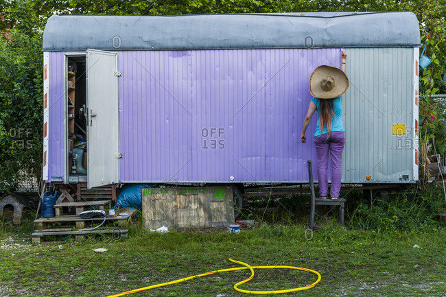Woman standing at a trailer