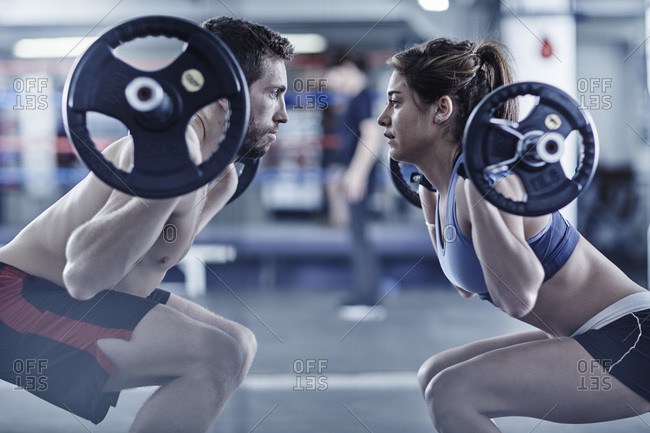 Man and woman doing fitness training with weights