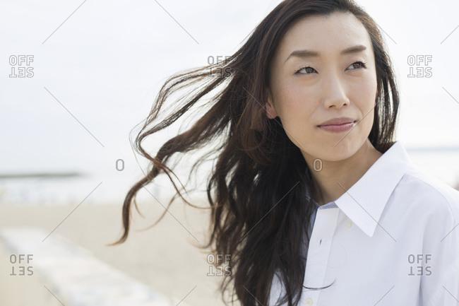A woman on a beach in Kobe, Japan