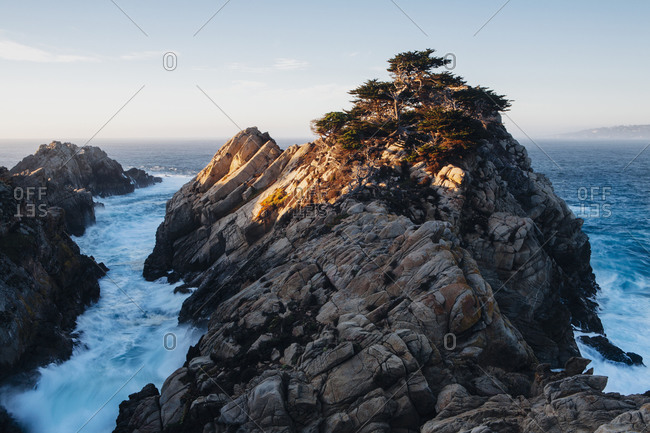 Dramatic cliffs and coastline at dusk in the Point Lobos State Reserve on the Pacific coastline White foaming water