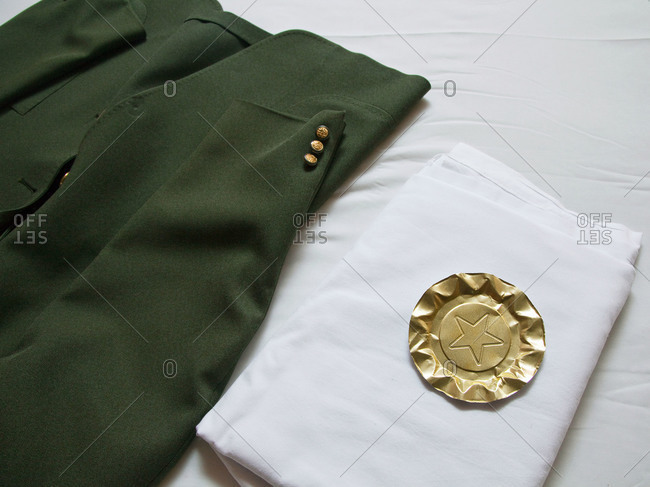 Folded uniform on a bed