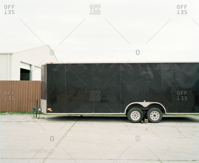 Black truck parking at a house