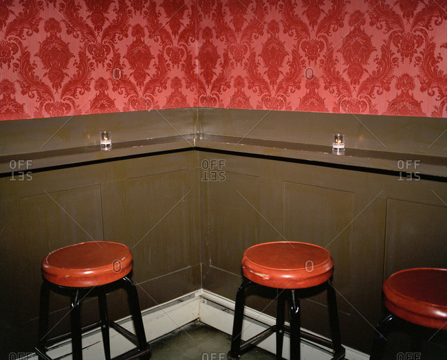 Red stools in a corner