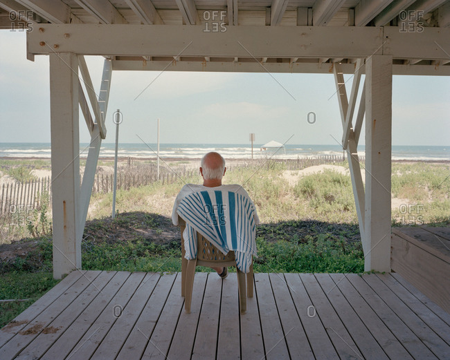 Man relaxing in a chair in a pavilion