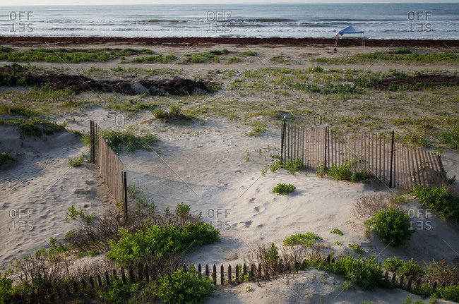 Fence on a sandy beach