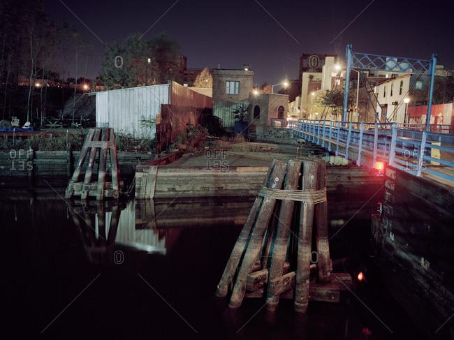 Dock and drawbridge in urban area at night