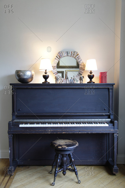 Piano with an old stool