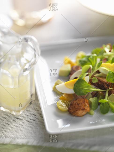 Blackened salmon cobb salad with microgreens