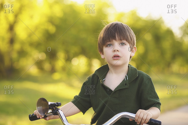 Young boy riding a bicycle