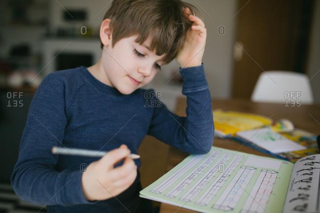 Boy working on his handwriting homework