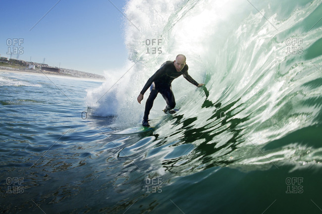 Surfer riding a pipeline wave